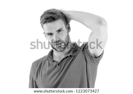 Effective antiperspirant. Man confident in his antiperspirant. Sportsman after training pleased with antiperspirant. Guy checks dry armpit satisfied with clean clothes. Prevent, reduce perspiration.