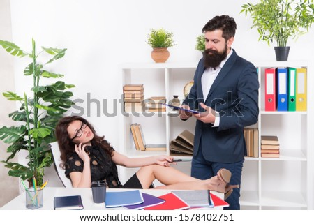 Effective management. Lady boss and office manager. Business communication. Business partners in manager office. Ceo and sexy secretary wear manager outfit. Manager and subordinate.