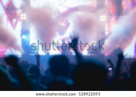 Effects blur Concert disco dj party newyear. People with hands up having fun #528922093