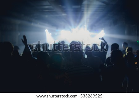 Effects blur Concert, disco dj party. People with hands up having fun #533269525