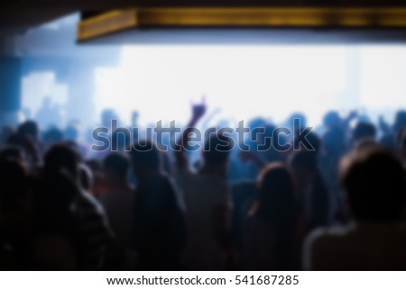 Effects blur Concert, disco dj party. People with hands up having fun  #541687285
