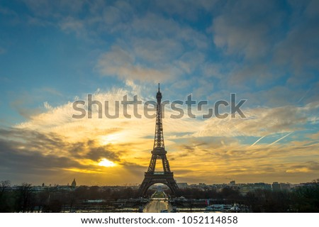 Effel tower of Paris in the  morning with the two colors sky tone blue and yellow.