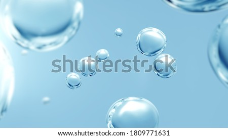 Effervescent fizz and clean cosmetics hygiene or rejuvenate renewable energy. Studio shot of transparent cosmetic blue gas bubbles under water in full-frame macro close up with selective focus blur.