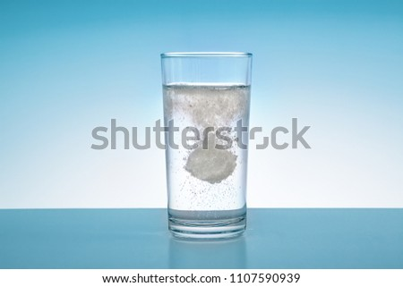Effervescent tablet falls in a water glass
