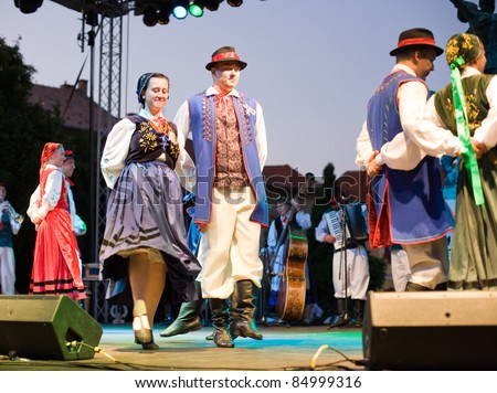 EGER - AUGUST 18: Traditional Hungarian folk dance performers on stage at night, as part of the St Stephen\'s Day\'s celebration, a national holiday in Hungary, on August 18, 2011 in Eger.
