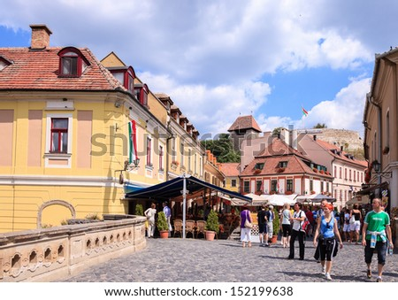EGER, HUNGARY - AUGUST 18: Street scene with tourists visitors charming city, on August 18, 2012 in Eger, Hungary. Eger is the second largest city in Northern Hungary.