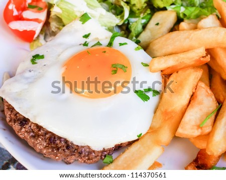 Egg and fries - classical english breakfast with egg and fries - stock photo