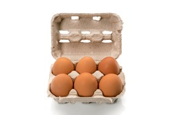 Egg box with eggs, six chicken eggs in cardboard egg tray made from recycled paper isolated on white background