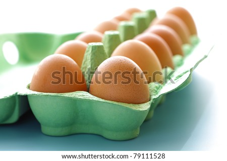 Egg carton containing a dozen eggs fresh free range eggs