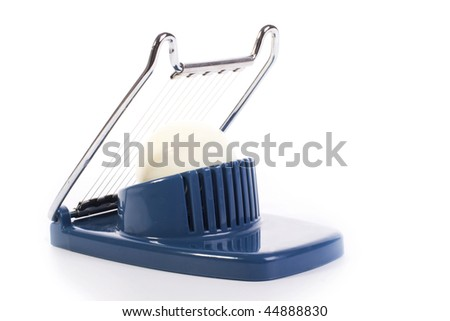 egg cutter with an egg isolated on white background