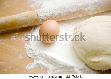 egg dough rolling pin - stock photo