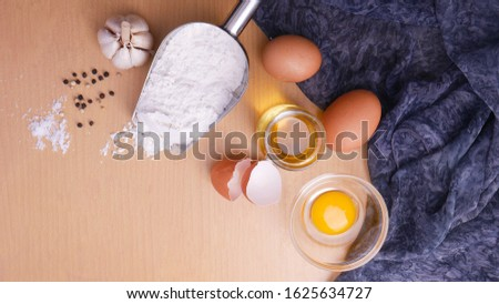 Egg, flour and garlic. ingredients. photo