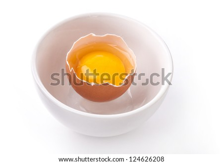Egg in bowl isolated on white background