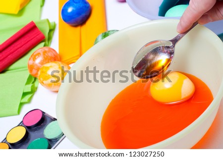 egg in orange  water bowl and spoon
