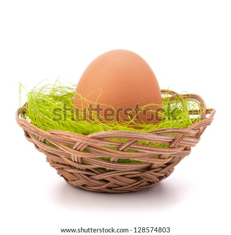 Egg in wicker basket isolated on white background cutout