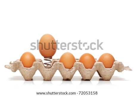 Egg jump out from container - stock photo