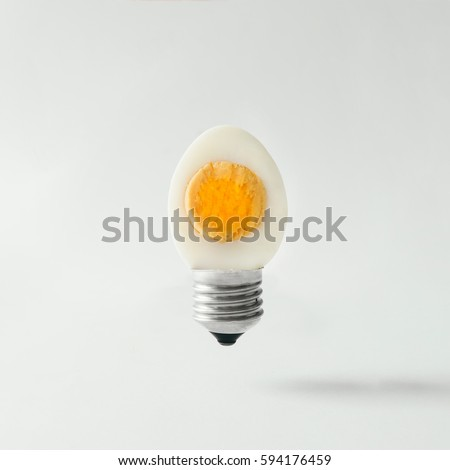 Egg lightbulb on bright background. Idea concept. #594176459