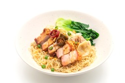 egg noodle soup with crispy pork belly and wonton isolated on white background