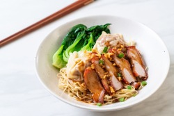 egg noodle with red roasted pork and wonton - Asian food style
