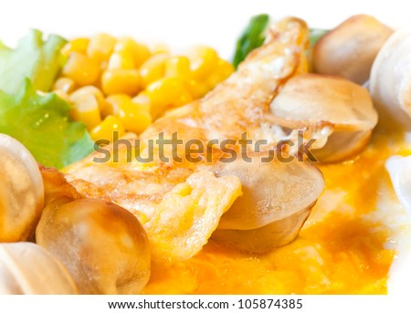 Egg omelet with vegetables and roasted pelmeni (meat dumplings). Modern daily Russian cuisine