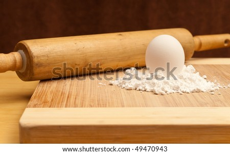 Egg on Top of Flour Pile with Rolling Pin