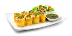 Egg Roll Stuffed with Chicken,carrots,onion and chili served Chili Sauce Cooked Healthy non MSG Goodtasty delicious diet or Appetizer Asian Food Thai style decorate with carved vegetables sideview