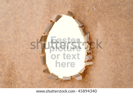 egg-shape hole in the kraft paper - stock photo
