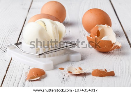 Egg slicer - cutter on white table