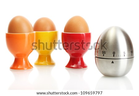 egg timer and egg in color stand isolated on white - stock photo