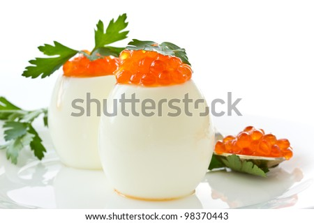 egg with red caviar on white background