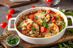 Eggplant baked with cheese, herbs and tomato sauce