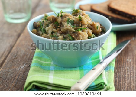 Eggplant caviar with parsley in a bowl #1080619661