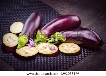 Eggplant on the table. Still life of eggplants. Dietary healthy food. Low-calorie product of healthy diet. Fresh sliced eggplant. Eggplant close up. #1293033199