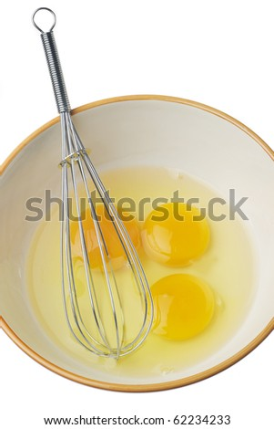 Eggs and whisk isolated on a white background - stock photo