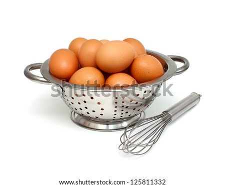 eggs and whisk isolated on white background