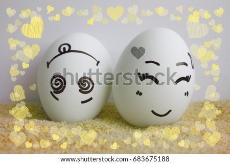 Eggs are cheerful with a face. Two pieces. Concept merry fellow. Photo for your design Frame of hearts. love #683675188