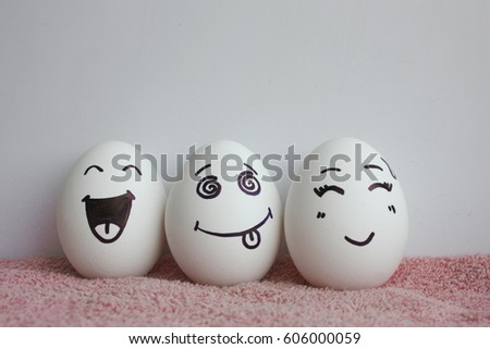 Eggs are funny with faces. Concept of laughter. Photo for your design on a white background