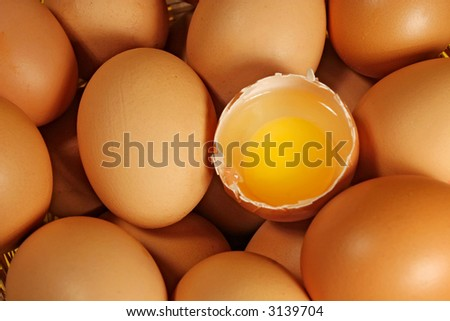 Eggs background (Eggs with one of them cracked)