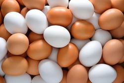 Eggs, brown and white in pile