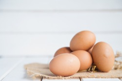 Eggs chicken on white wood background