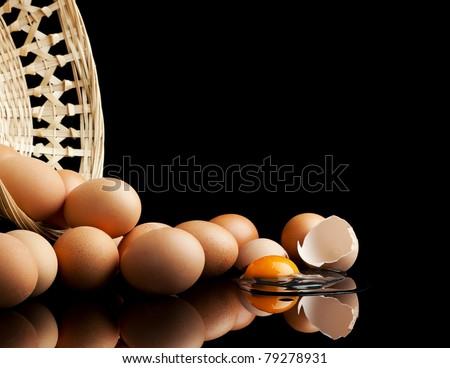 eggs falling from a basket, one is broken