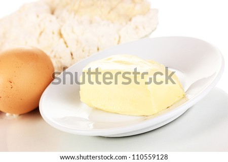 Eggs, flour and butter close-up isolated on white