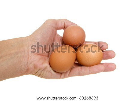Eggs in a hand on a white background