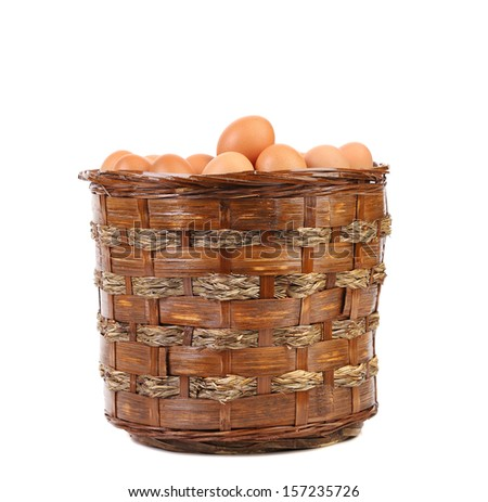 Eggs in a wicker brown basket. Isolated