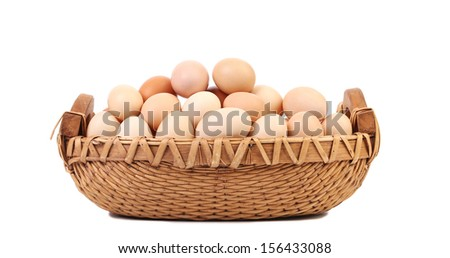 Eggs in basket.  Isolated on a white background