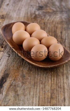 eggs in bowl on a wooden old boards, Stock fotó ©