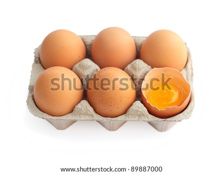 Eggs in cardboard container isolated on white background