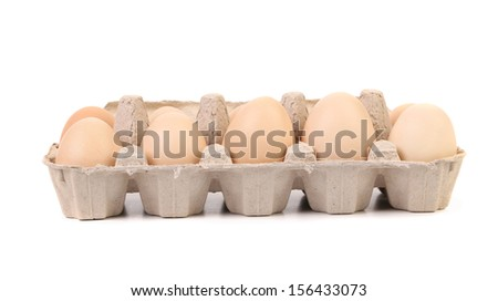 Eggs in protective case foreground close-up. White background.