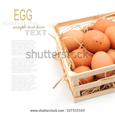 Eggs in wooden box on hay nest isolated on white