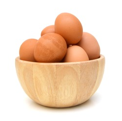 Eggs isolated in wooden bowl on white background